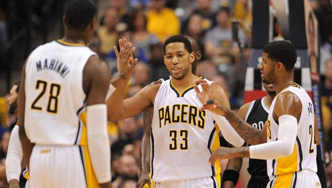 Indiana Pacers forward Danny Granger meets with his teammates against the Brooklyn Nets during the second half, Saturday, December 28, 2013, at Bankers Life Fieldhouse.