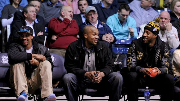 Indiana Pacers George Hill, David West and Paul George sit court side at the Butler against Xavier game inside Hinkle Fieldhouse, Tuesday, February 11, 2014, in Indianapolis.