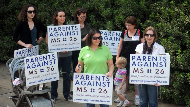 Parents against the Mississippi Initiative 26 attend a rally at the State Capitol in 2011.