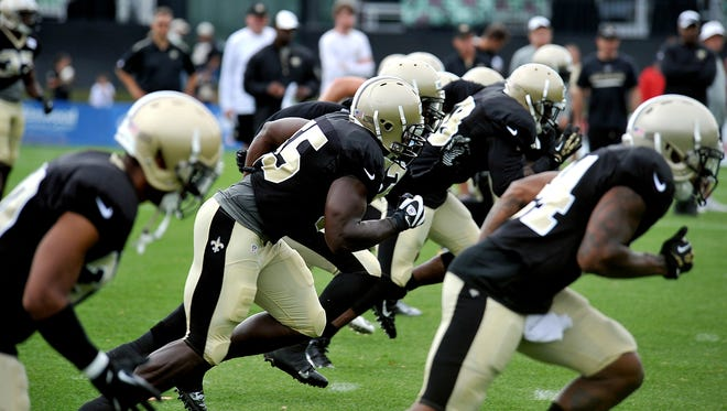 New Orleans Saints players run sprints during there NFL football training camp in White Sulphur Springs, W. Va., on Sunday.