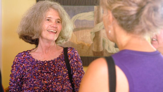 Judi Jennings', Executive Director at the Kentucky Women's Foundation, laughs with friends at her retirement party at the KWF's Hopscotch House in Prospect.  June 22, 2014