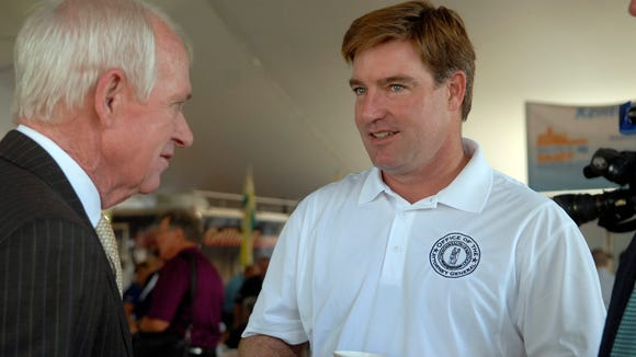 Kentucky Attorney General Jack Conway talks with Kentucky State Fair Board member Lanny Greer during the commodities breakfast that opens the Kentucky State Fair.