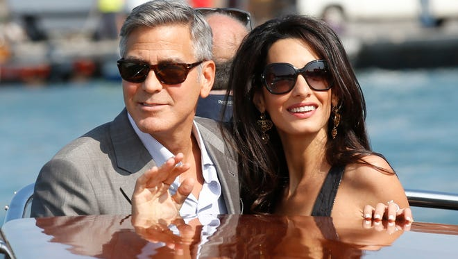 George Clooney, left, and Amal Alamuddin arrive in Venice.