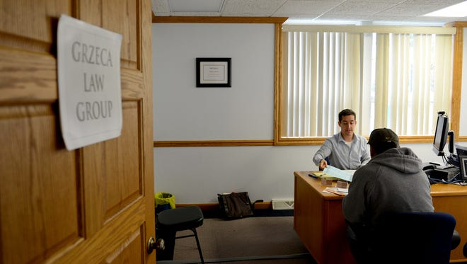Immigration attorney Ben Crouse, of Grzeca Law Group, meets with a client at Casa ALBA Melanie in Green Bay, Wis.
