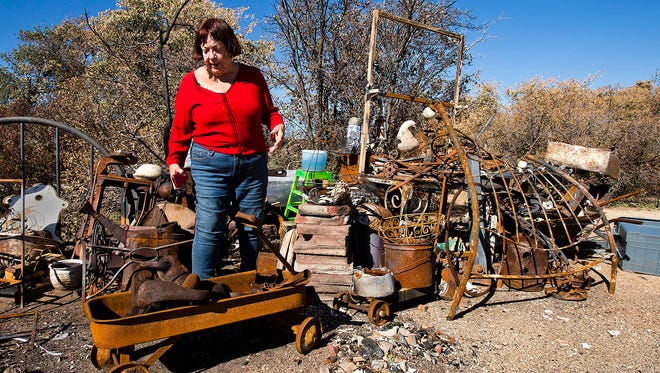 Roberta Era stands among what is left of her Glen Ilah, Ariz., home after it burned to the ground in the Yarnell Hill Fire in June. She barely escaped before flames overtook her neighborhood.