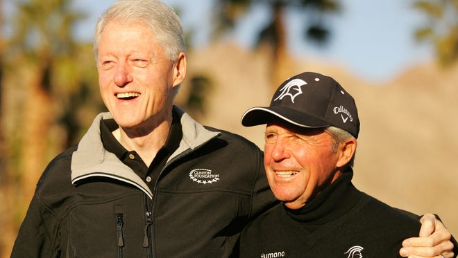 Former President Bill Clinton asks for a photo with veteran golfer Gary Player on the first tee at PGA West's Palmer Private Course on Thursday, Jan. 17, 2013, during the first day of the Humana Challenge golf tournament. The Health Matters health and wellness conference will take place Tuesday, Jan. 14, 2014, during this year's Humana Challenge.