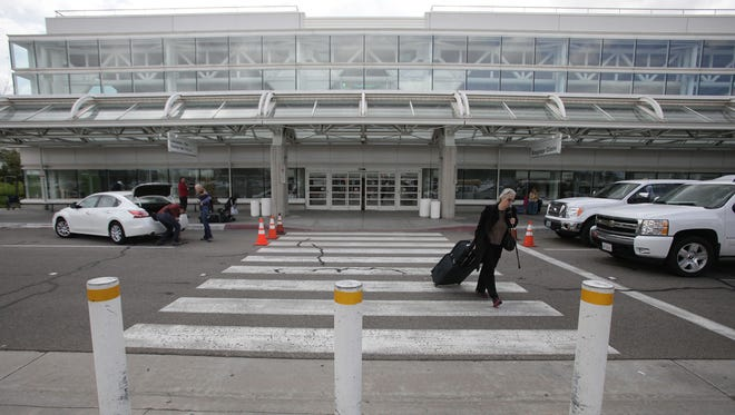 Travelers come and go outside the relatively quiet Terminal 4 at Ontario International Airport on Thursday, March 27, 2014. The airport has seen a 44.9% drop in passengers from 2007 to 2013.