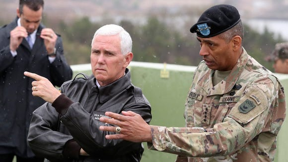 Vice President Mike Pence is briefed near the border