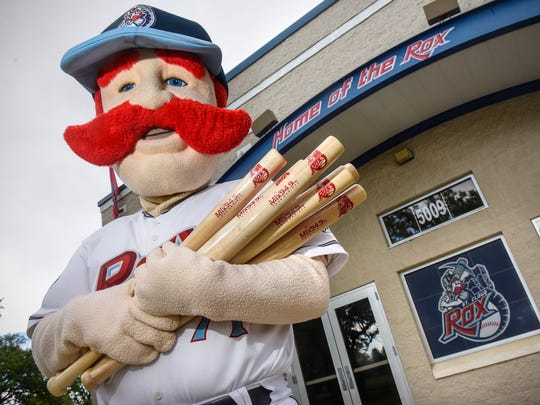 St. Cloud Rox mascot Chisel holds an armful of promotional bats in preparation for the upcoming season Friday, May 25, 2018, at Joe Faber Field in St. Cloud.