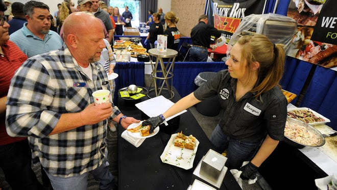 Meagan McBride, with the 1881 food truck, gives out mini lobster rolls during the Taste of Abilene on Tuesday, April 19, 2016, at the Abilene Civic Center.