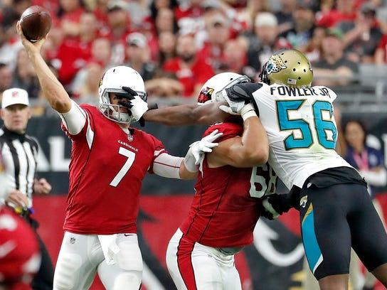 Arizona Cardinals quarterback Blaine Gabbert (7) throws under pressure from Jacksonville Jaguars defensive end Dante Fowler (56) during the first half of an NFL football game, Sunday, Nov. 26, 2017, in Glendale, Ariz. (AP Photo/Rick Scuteri)