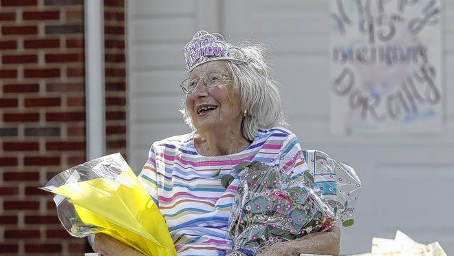 "Dorothy ""Pete"" Peterson of Pickerington is all smiles as her friends and neighbors drive by her house as part of a parade for her 95th birthday on June 3."
