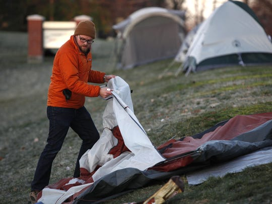 Dustin Nimmo of Mt. Washington breaks down his tent