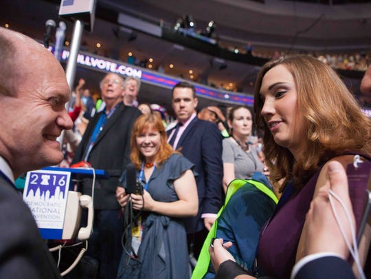 LGBT rights activist Sarah McBride is greeted by Sen.