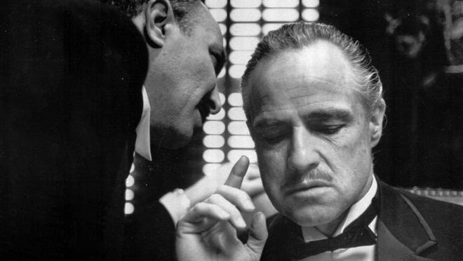 """Dick Smith's makeup gave Marlon Brando's Don Corleone a bulldog presence in this scene from the 1972 film, """"The Godfather."""""""