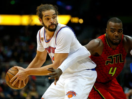 FILE - In this Jan. 29, 2017 file photo, New York Knicks center Joakim Noah (13) looks to pass as Atlanta Hawks forward Paul Millsap (4) is defending in the first overtime of an NBA basketball game in Atlanta.  Noah has been suspended 20 games without pay for violating the league's anti-drug policy.  The NBA announced the suspension Saturday, March 25 saying Noah tested positive for Selective Androgen Receptor Modulator LGD-4033 _ something found in some over-the-counter supplements. (AP Photo/Todd Kirkland)