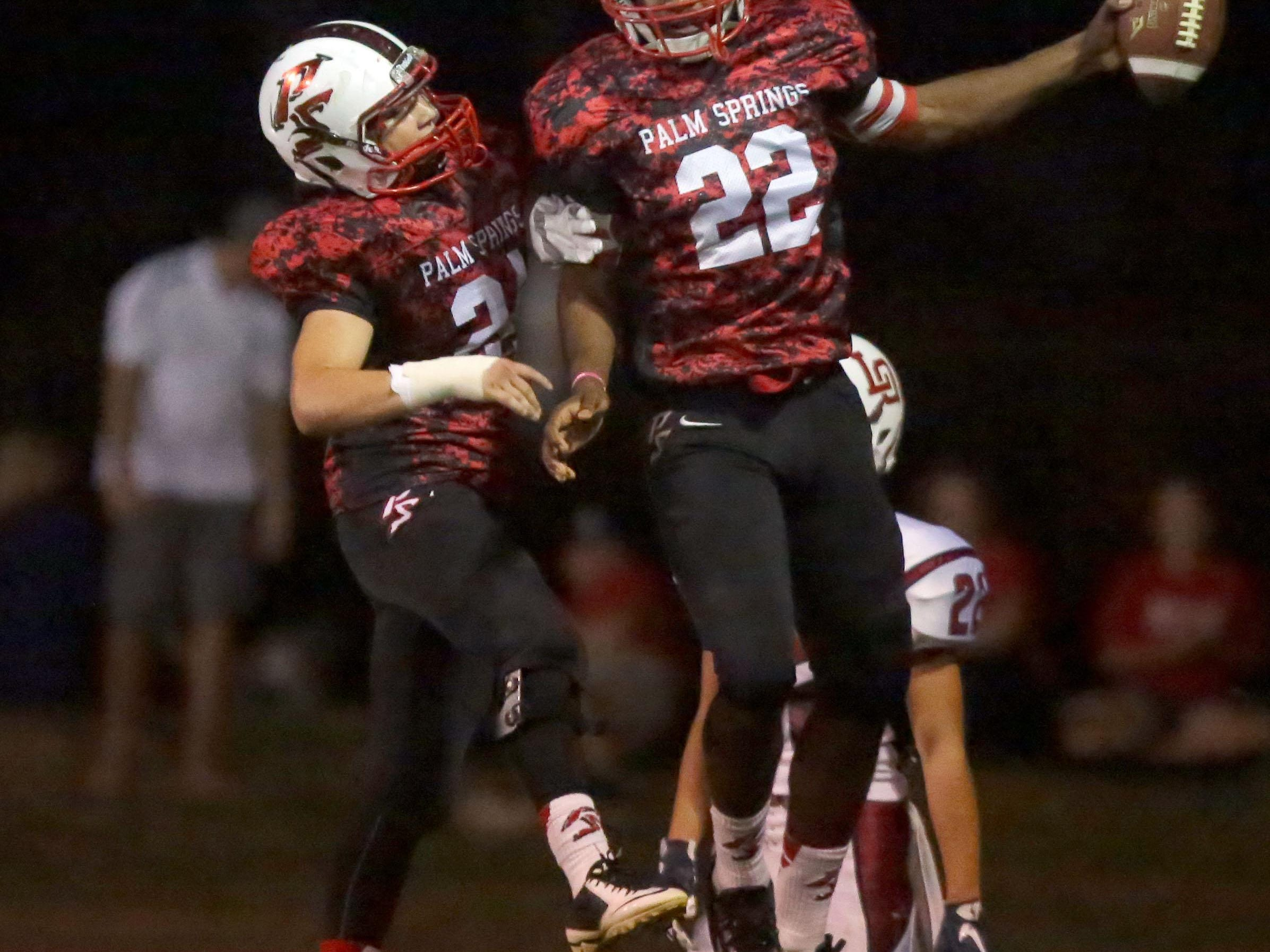 Damion Lee celebrates his second quarter touchdown against La Quinta with teammate Noah McGuire on Friday.