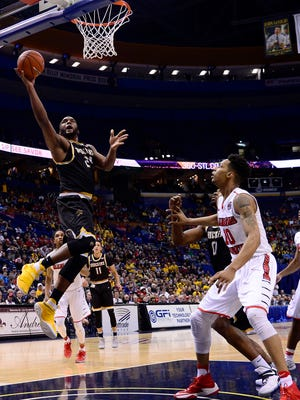 Wichita State Shockers center Shaquille Morris drives to the basket.