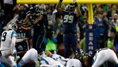 Kam Chancellor #31 of the Seattle Seahawks blocks Graham