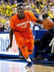 Syracuse Orange guard Kaleb Joseph (14) moves the ball