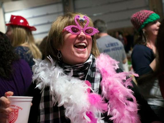 SHRIMP FESTIVAL: Cindy Gray, of Newark, dances during the 24th Annual Shrimp Feast at the Lewes fire station.