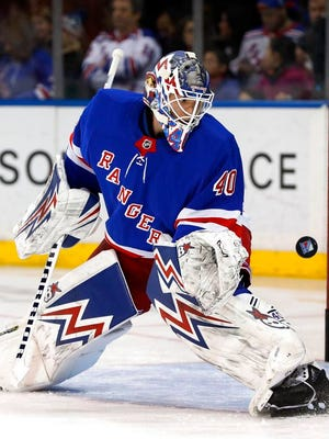 New York Rangers goaltender Alexandar Georgiev (40) stops the puck as he warms up prior to the start of an NHL hockey game against the Buffalo Sabres, Friday, Feb. 7, 2020, in New York.