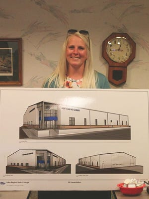 Mylee Kenner, program coordinator for the Precision Ag Program at LRSC spoke at the Devils Lake Kiwanis Club Tuesday, July 14. Here she shows the newest artist's renditions of the Hofstad to be built on the LRSC campus.