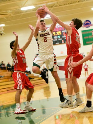 Oak Harbor's Jac Alexander tries to split two Huron defenders Tuesday.