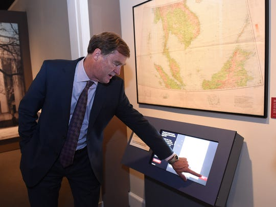 Paul Sparrow, director, FDR Museum and Library demonstrates an interactive display in the Day of Infamy exhibit that allows guests to explore why the attack on Pearl Harbor was a surprise during a press tour on Wednesday. The Day of Infamy exhibit opens on June 30th.