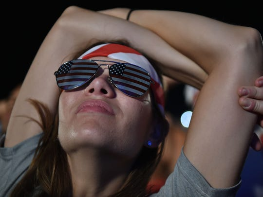 A USA fan reacts while watching a 2014 World Cup Group G soccer match USA vs Portugal on a giant screen in Rio de Janeiro, on June 22, 2014.