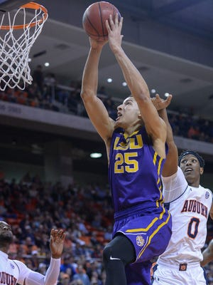 LSU forward Ben Simmons (25) scores two over Auburn forward Horace Spencer (0) Tuesday, Feb. 2, 2016, during the first half of an NCAA college basketball game at Auburn Arena in Auburn, Ala. (Julie Bennett/AL.com via AP) MAGS OUT; MANDATORY CREDIT