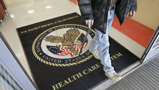 In this April 2, 2015, file photo, a visitor leaves the Sacramento Veterans Affairs Medical Center in Rancho Cordova, Calif.