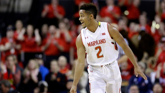Melo Trimble reacts after nailing a 3-pointer for Maryland in its victory over Michigan State on Saturday. The freshman guard had 21 points in the first half for the Terrapins (17-2, 4-1 Big Ten).