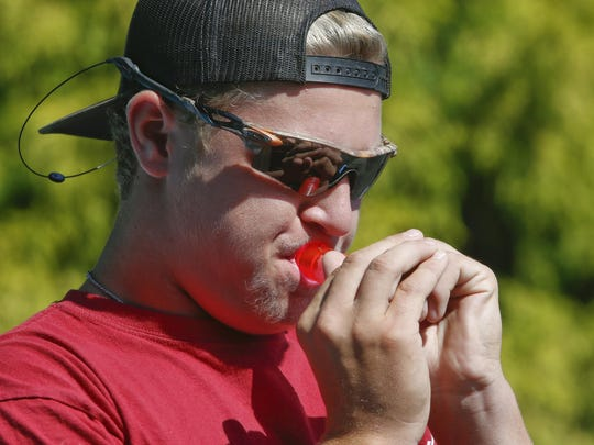 Luke Hatton, 15, of Elkton, Md., blows a call in the junior goose call competition during the 2015 Delaware State Duck Calling Championship at Captain Bones Bait and Tackle in Odessa Saturday.