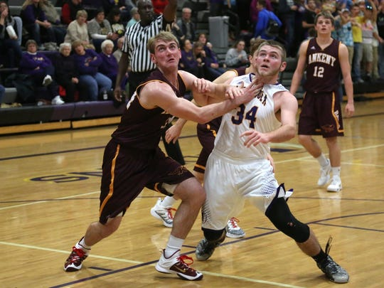 Ankeny's Riley McCoy battles Indianola's Connor Davidson for rebounding position on a free-throw attempt during a game on Dec. 15 at Indianola. McCoy scored five points as the sixth-ranked Hawks remained unbeaten with a 70-52 victory.