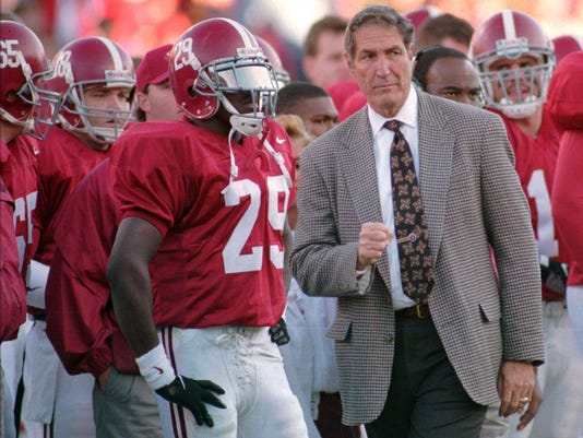 File- This Nov. 4, 1995, file photo shows Alabama coach Gene Stallings walking the sidelines during the Tide's 10-3 win over Louisiana State University Tuscaloosa, Ala. Stallings says he's recovering from a stroke. Stallings told Alabama news outlets in telephone interviews from his home in Paris, Texas, that it happened Thursday, May 18, 2017. He was in Montgomery, Alabama, for a banquet where he introduced the speaker: Dabo Swinney, his former player and now head coach at Clemson.(AP Photo/stf, File)
