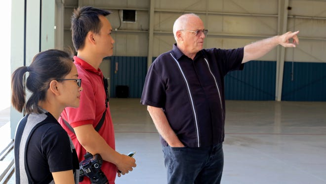 Duy Tan University's Le Thi Thanh Thao, a CGI studio manager, and Nguyen Bao, a photographer, get a tour of the new Dixie State University Film Studios at the former St. George Airport on Sept. 2 from Phil Tuckett, director of DSU's film program.