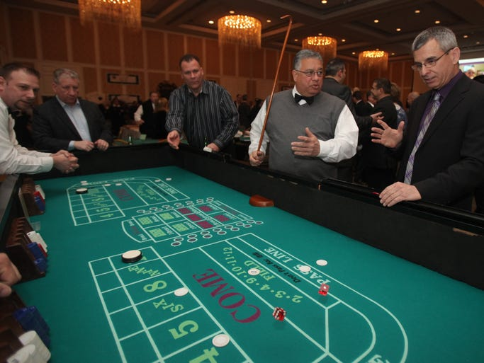 James Guerriere, C delegate of PBA New York State Troopers plays craps during the New York State Troopers PBA Signal 30 Benefit Fund's 5th Annual Casino Night Benefit at the Doral Arrowwood Resort in Rye Brook on  March 7, 2014.