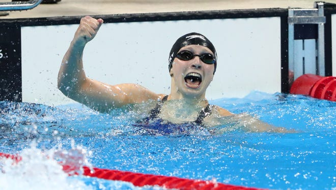 Katie Ledecky broke her own world record in the 400-meter freestyle by nearly two seconds.