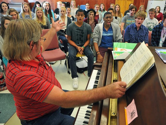 In this 2015 file photo, Gary Miller (left), choral director at Indian River Charter High School, prepares students for a trip to Carnegie Hall in New York City.
