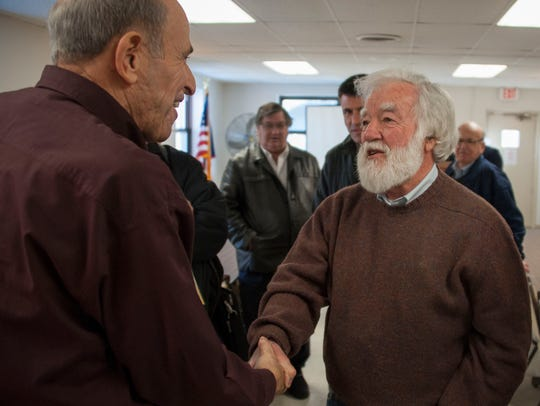 Grant Milliron, right, shakes hands with Bill Bader