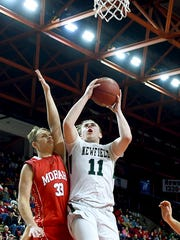 Josh Wood (11) of Newfield attempts to shoot as Jay