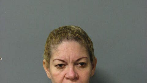 Karen Pastor-Newry, aka Karen Dominguez, was charged with Workers' Comp misrepresentation and theft.