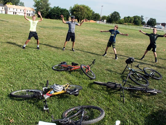 Members of the Hanover Area Youth Cycling Club do jumping