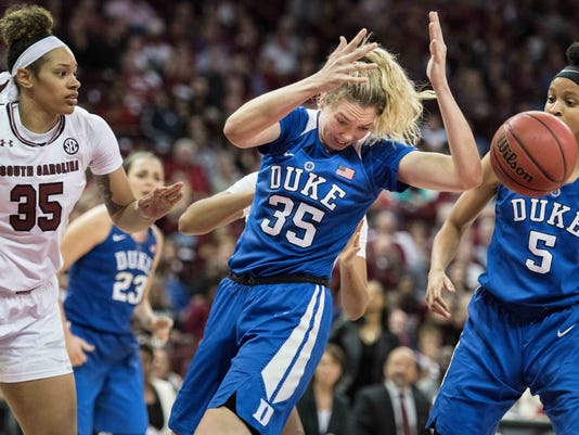 Duke center Erin Mathias, center, and Leaonna Odom (5) battle for the ball against South Carolina forward Alexis Jennings, left, during the second half of an NCAA college basketball game Sunday, Dec. 3, 2017, in Columbia, S.C.(AP Photo/Sean Rayford)