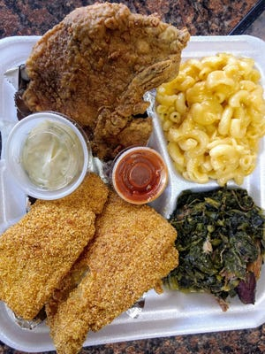 This two-meat, two-sides meal from Sister's Soul Food has a fried pork chop, cornmeal-crusted fish, greens with smoked turkey, and mac and cheese.