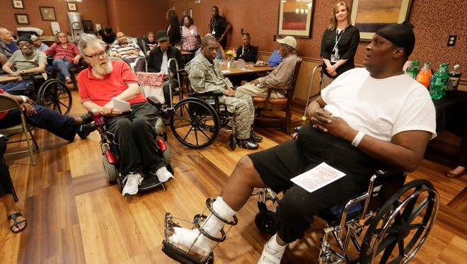 """Lamont Harris, a veteran, tells where he served during recognitions during Seasons Hospice & Palliative Care  """"We Honor Veterans"""" day program to give pins and certificates to veterans they are caring for at The Villa at Bradley Estates."""