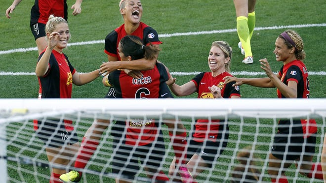 WNY Flash's Lianne Sanderson jumps on Abby Erceg who scored for a 2-1 lead against the Seattle Reign which would remain through the first half at Frontier Field.