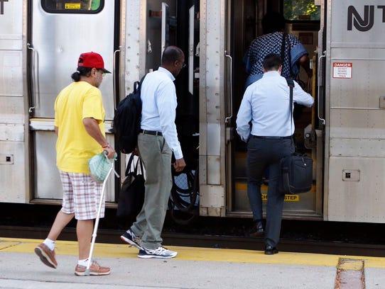 Spring Valley passengers board an NJTransit train bound