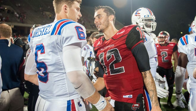 Sep 10, 2015; Bowling Green, KY, USA; Western Kentucky Hilltoppers quarterback Brandon Doughty (12) shakes hands with Louisiana Tech Bulldogs quarterback Jeff Driskel (6) after the second half at Houchens Industries-L.T. Smith Stadium. Western Kentucky Hilltoppers won 41-38. Mandatory Credit: Joshua Lindsey-USA TODAY Sports